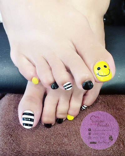 Yellow Toe Nail with Smiling Face for Summers