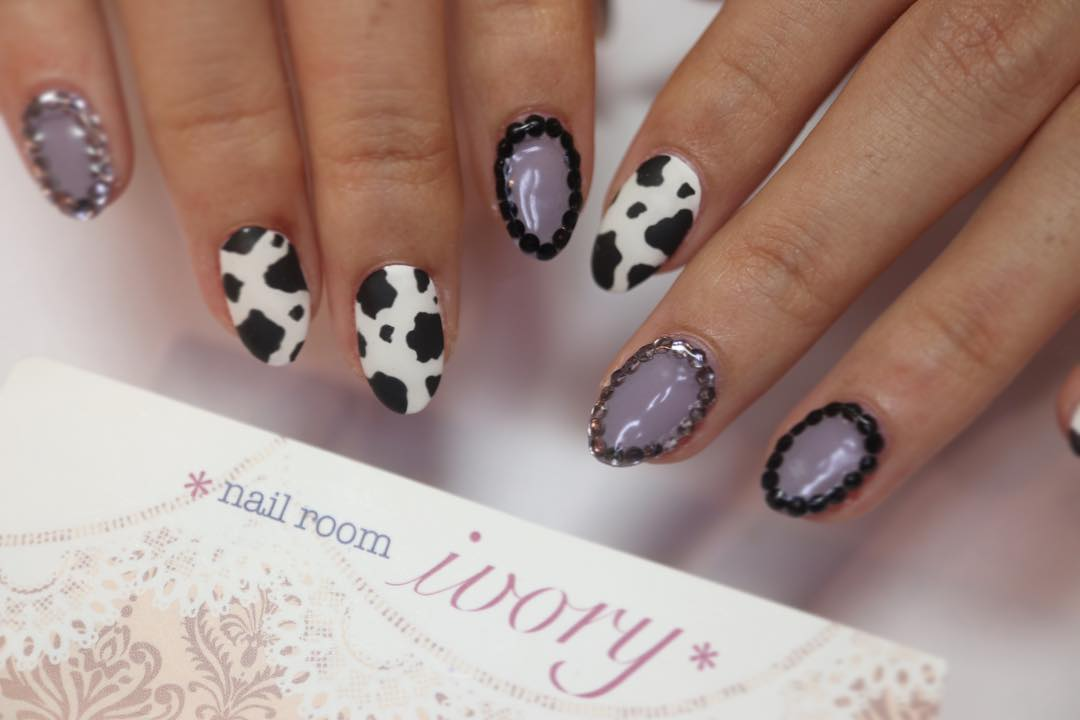 Purple Nail Art with Cow Design