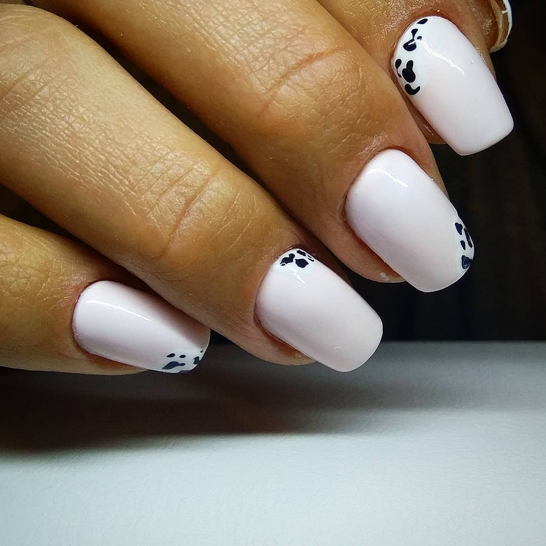 Unique White Nails with Cow Design
