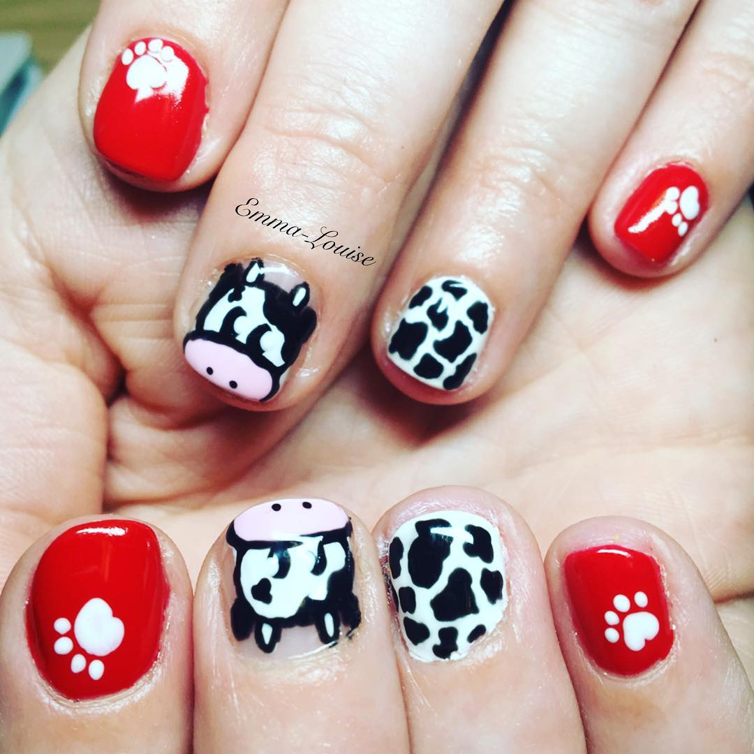 Stunning Red and Cow Design Nail Art with Paw