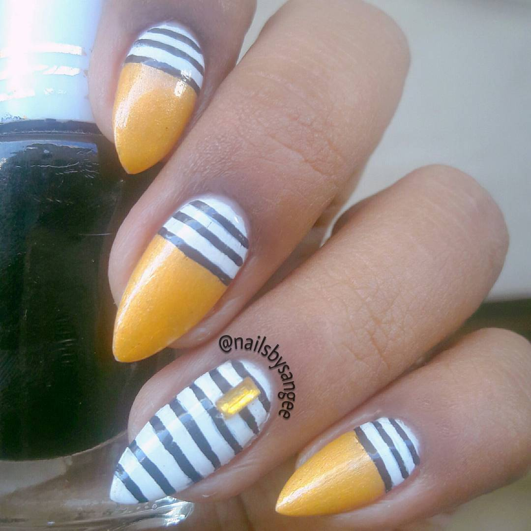 Elegant Golden Nails with Black and White Design