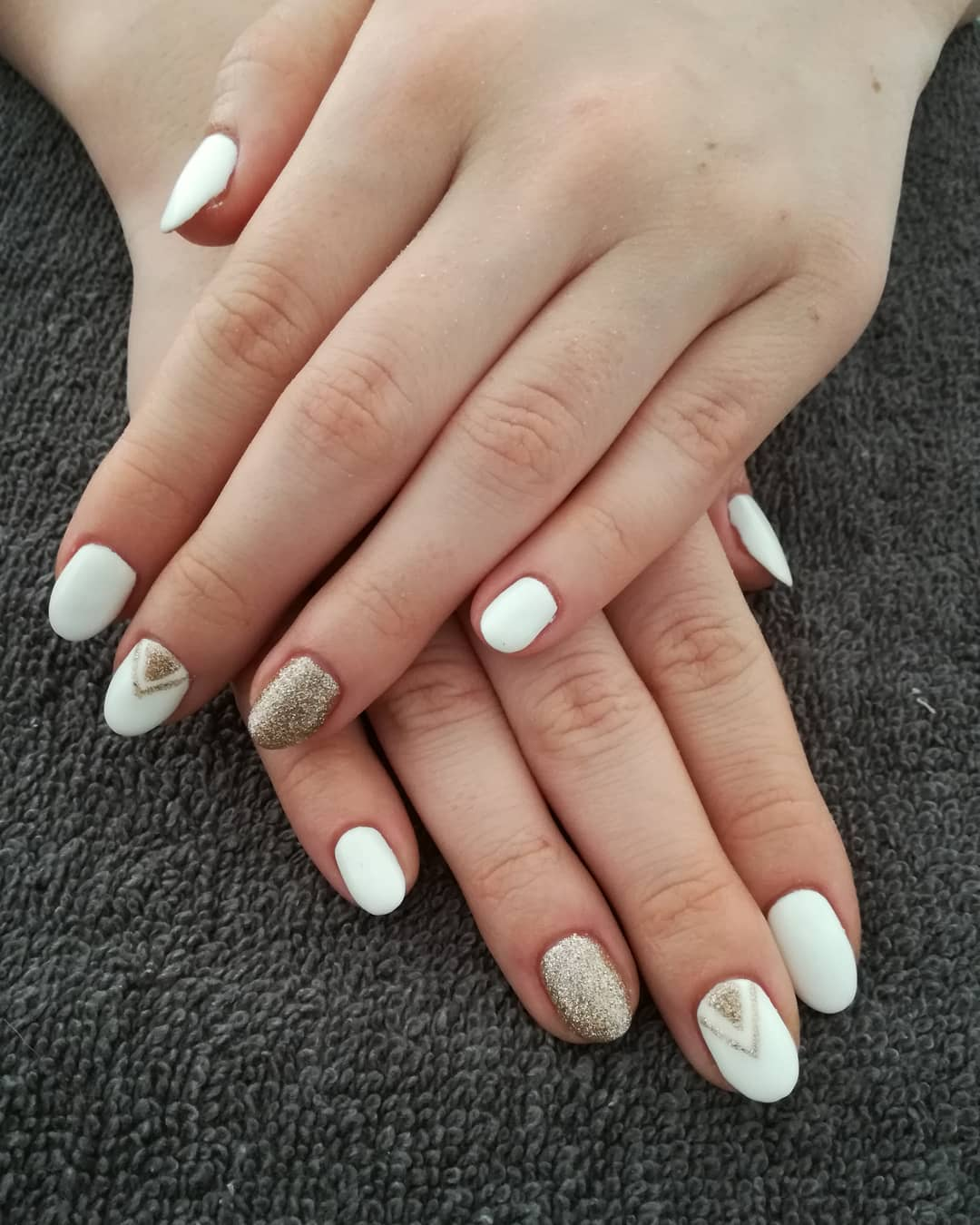 Fashionable White Nails with Golden Nail Art
