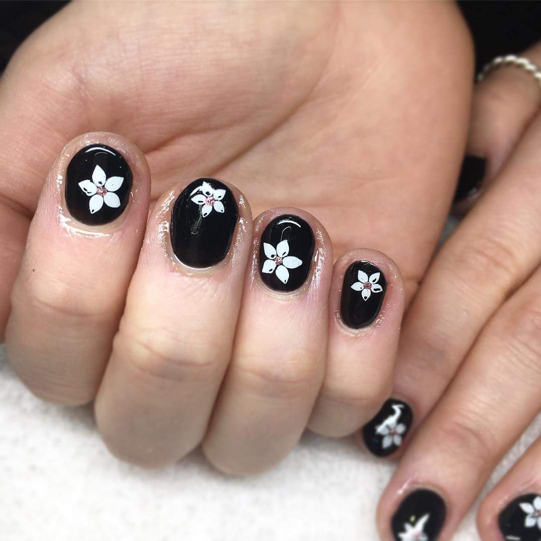 Glossy Black Base With White Flowers To Try Once