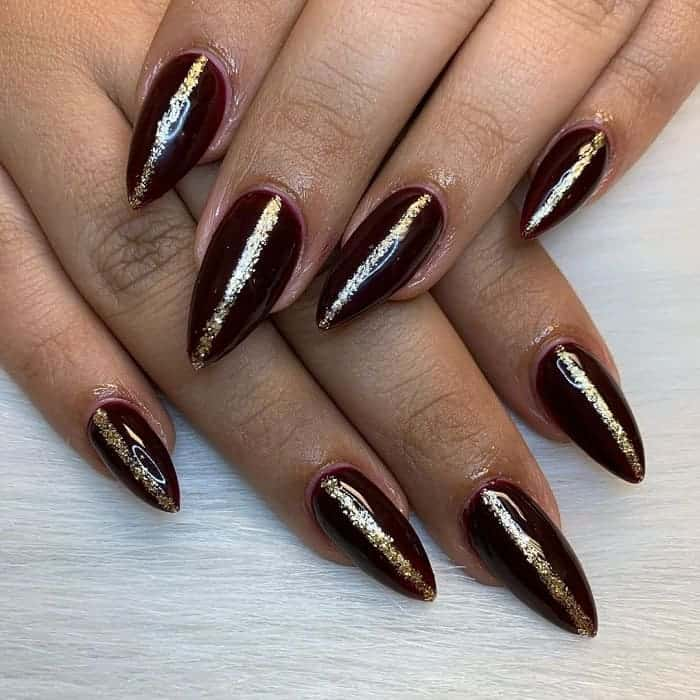 maroon and gold stiletto nails