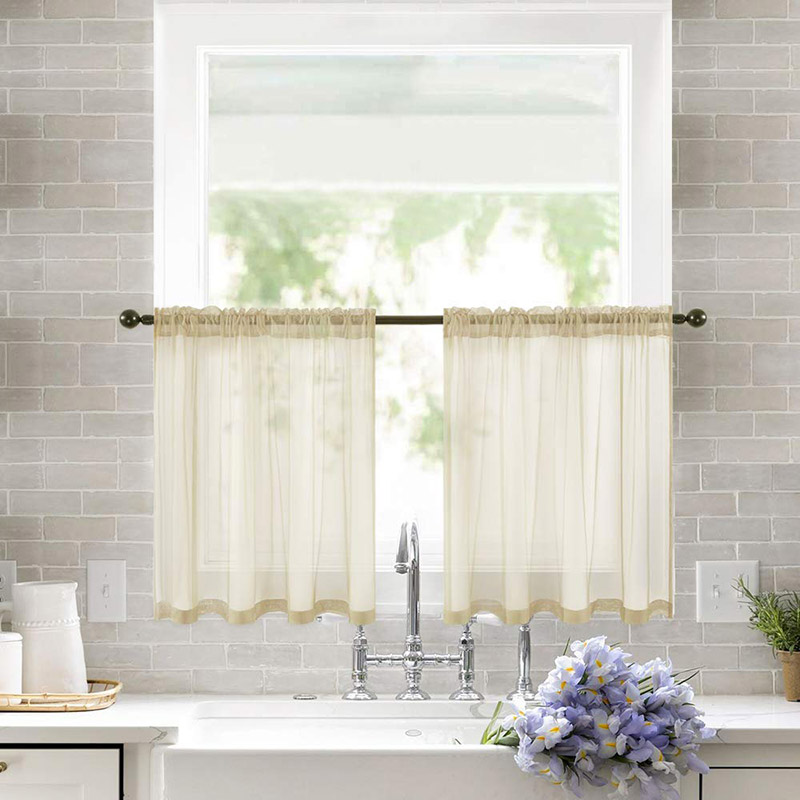 Semi-transparent curtain with beigne valance, above sink in the kitchen.